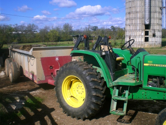 Spreader attached to tractor