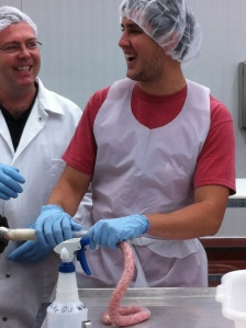 A student in lab learning to make sausage.