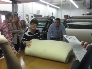 Kids on a field trip to a wool processor. They made yarn, blankets, and sweaters.