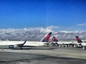 Salt Lake City airport is full of Delta planes and Mountains. But it's an airport with one of the best views - from both inside the airport and up in the sky.